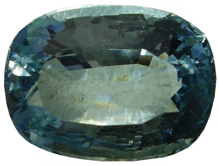 Close up view of a cushion cut faceted Aquamarine Gemstone