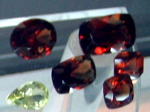 Ceylon Red Zircons and a white zircon with different types of cuts