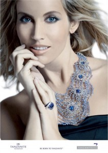 A model wearing round brilliant cut natural tanzanite gemstones set in an exquisitely crafted necklace. The model is also wearing a round brilliant cut gemstone set in a ring. A press release photo from the TanzaniteOne Mining Group.