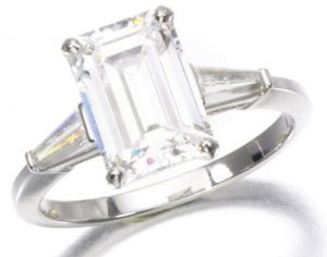 Lot 169, Diamond Ring set with a 3,42-carat, emerald-cut diamond between baguette diamond shoulders