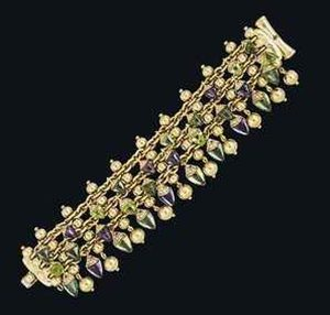 "Lot 99 - An 18ct gold gem-set ""Naturalia"" Bracelet by Bulgari"