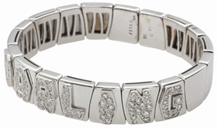 Lot 08 - Diamond and White Gold Bangle Bracelet - by Marina B.