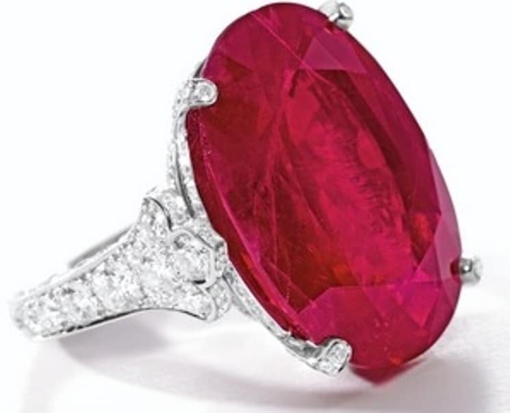 Lot 1762-An Impressive and Important Ruby and Diamond Ring mounted by Cartier