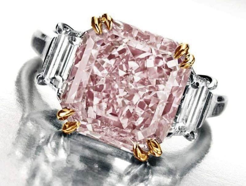 Lot 131- Harry Winston Ring incorporating the 6.10-carat, fancy intense pink diamond