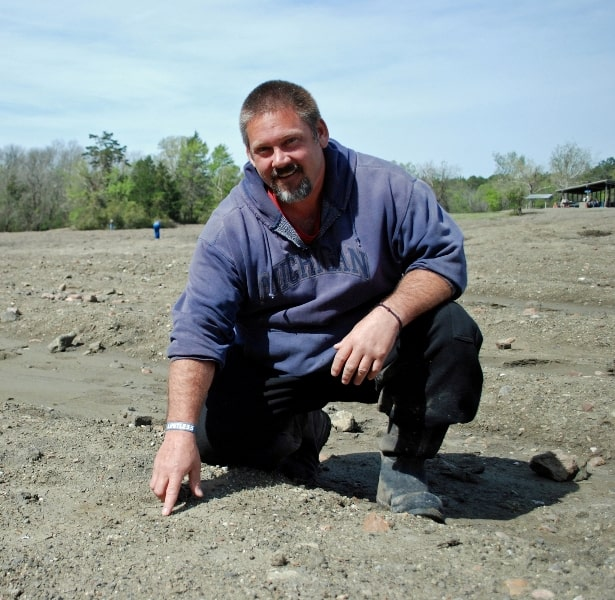 David Anderson pointing to the area where the diamond was discovered