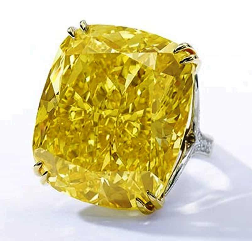 Lot 507 - 100.09-carat Graff Vivid Yellow diamond in its present ring setting