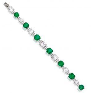 Lot 457 - Elegant Platinum, Emerald and Diamond Bracelet - by Cartier