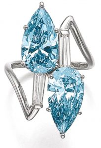 """Lot 526 - """"toi et moi"""" ring set with set with pear-shaped fancy-vivid blue and fancy intense blue diamonds"""