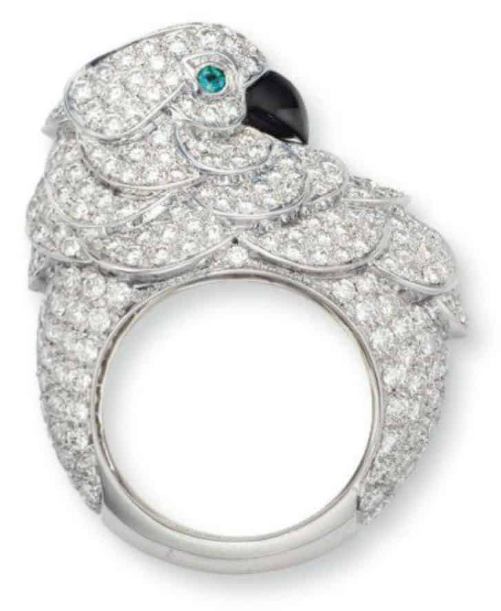 Lot 46 - Diamond, emerald and onyx parrot ring by Cartier