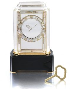 Lot 453 - Rock crystal, mother-of-pearl, onyx and diamond, Model A Mystery Clock by Cartier, designed in 1927