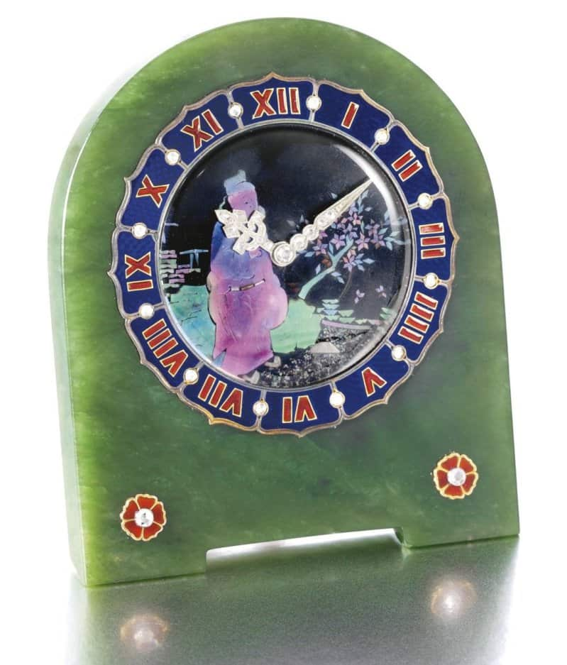 Lot 449 - Nephrite, enamel, mother-of-pearl,  and diamond clock  by Cartier designed in 1925