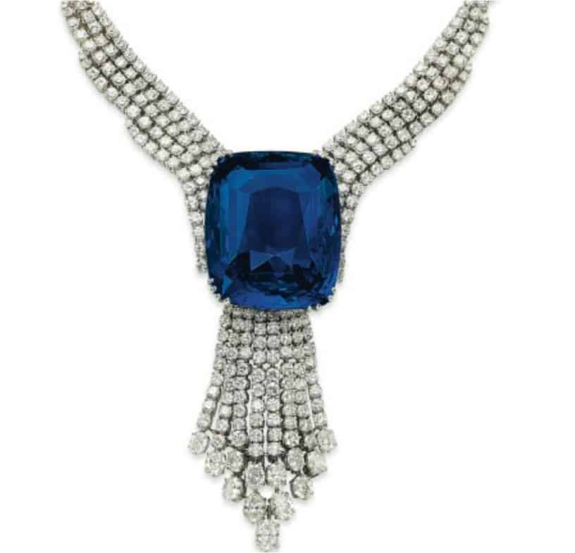 Blue Belle of Asia with diamond tassel pendant suspended from it, in a diamond necklace