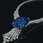Blue Belle of Asia with a diamond tassel pendant suspended from it in a diamond necklace