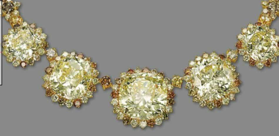 Lot 267 - Five yellow, cushion-shaped diamonds of the impressive colored diamond necklace