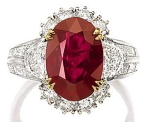 Lot 1470 - A Fine Ruby and Diamond Ring by Cartier