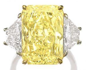 Lot 1385 - Fine Fancy Intense Yellow Diamond and Diamond Ring