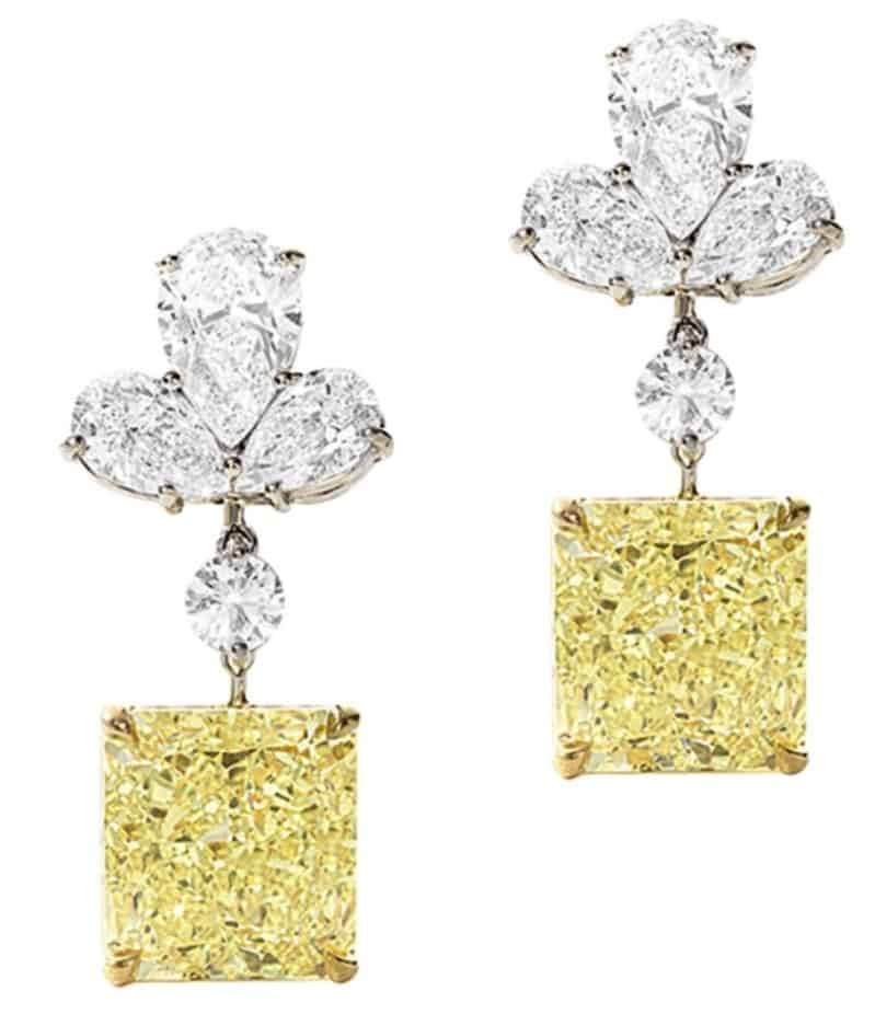 Lot 1386 - Pair of Fancy Intense Yellow Diamond and Diamond Ear Clips