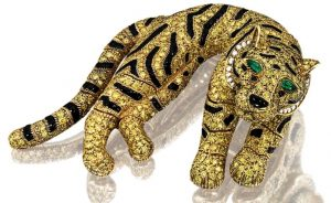 Lot 1480 - A Charming Yellow Diamond, Diamond, Onyx And Emerald Tiger Clip Brooch - by  Cartier