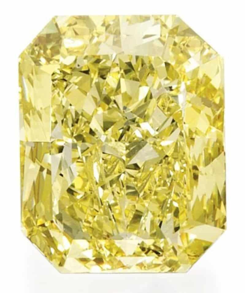 Lot 337 - An Impressive Platinum, 18k-Gold, Fancy Vivid Yellow Diamond And Diamond Ring