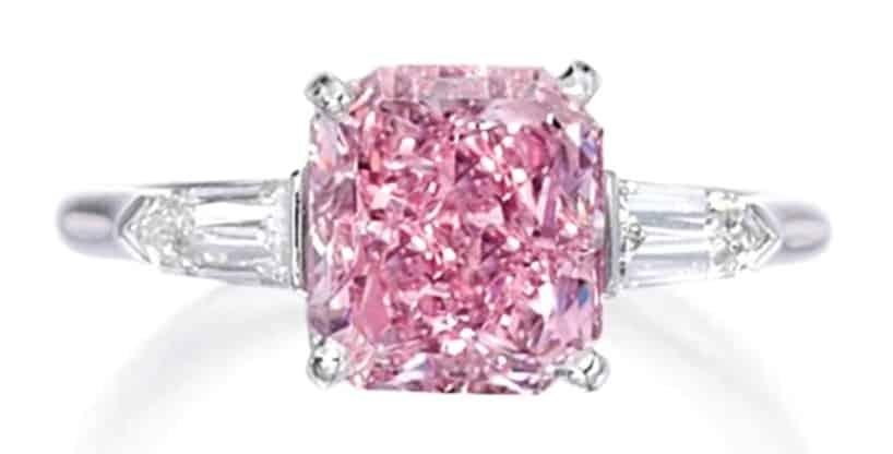 Lot 398 - A Fine Platinum Fancy Intense Purplish-Pink Diamond And Diamond Ring