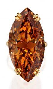 Lot 407 - An Impressive Fancy Deep Brown-Orange Diamond Ring