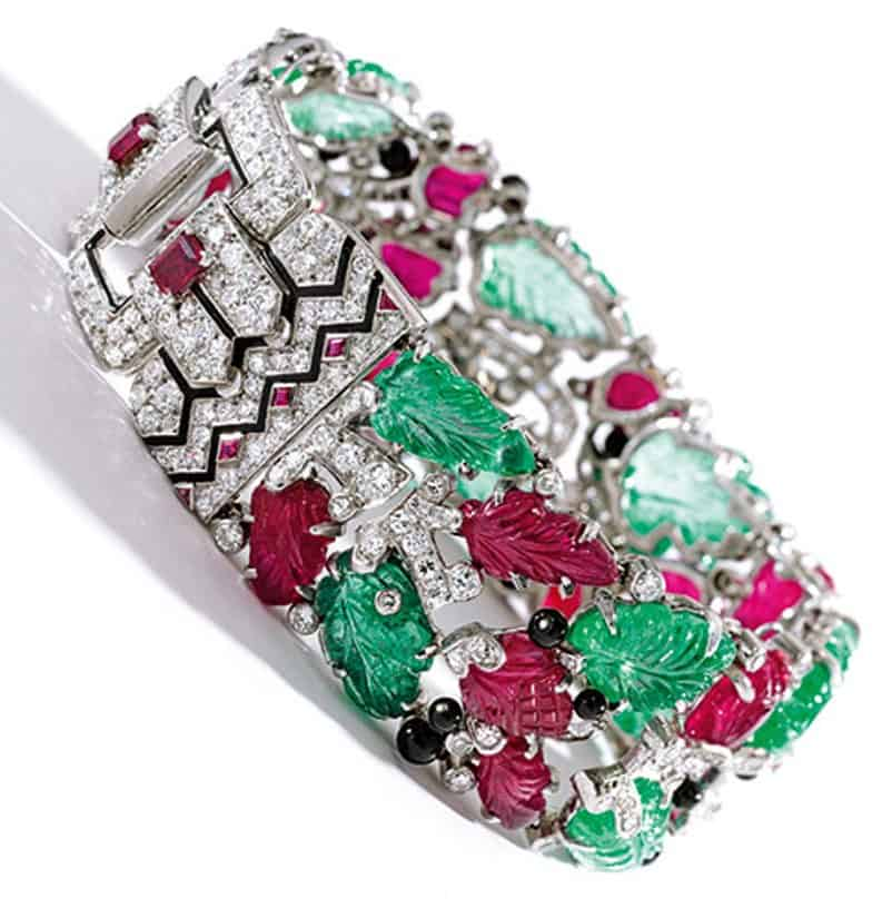 Lot 395- An Iconic Platinum, Colored-stone, Diamond And Enamel Tutti Frutti Bracelet by Cartier, New York