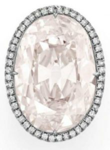 Lot 314 - Top view of a rare colored diamond and diamond ring