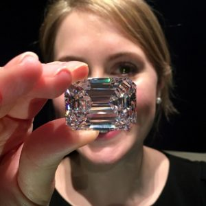 The Ultimate Emerald-Cut Diamond held by a Sotheby's employee