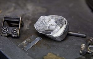 Another photograph of the rough diamond during the cutting and polishing process