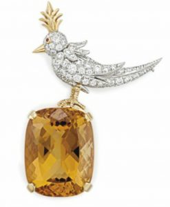 "Lot 12 - A diamond, citrine and ruby ""bird on a rock"" brrooch by Jean Schlumberger, Tiffany & Co."