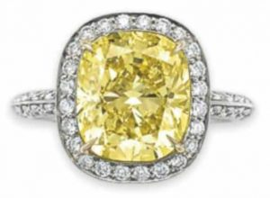 Lot 307 - A Colored Diamond and Diamond Ring by Tiffany & Co.