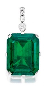 Lot 165 - Important Platinum, Emerald and Diamond Pendant. The Flagler Emerald