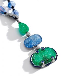 Lot 364 - Pendant enlarged showing carved emeralds and sapphire