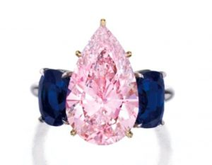 Lot 362 - A Magnificent Platinum, 18k-Gold, Fancy Purplish-Pink Diamond and Sapphire Ring