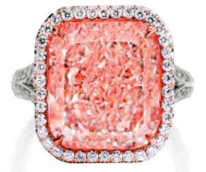 Lot 121 - An Important Platinum, 18k-Rose-Gold,  Fancy Light Pink Diamond and Diamond Ring