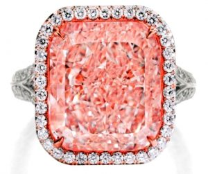 Lot 121 - An Important Platinum, 18K Rose-Gold, Fancy Light PInk Diamond And Diamond Ring