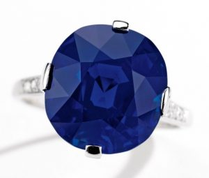 Lot 365 - A Superb Platinum, Sapphire and Diamond Ring by Cartier, New York