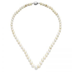 Lot 422 - A single-strand natural pearl and diamond necklace by Cartier