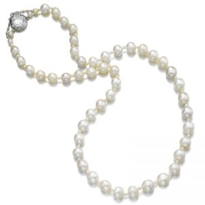 Lot 473 - Impressive Natural Pearl and Diamond Necklace