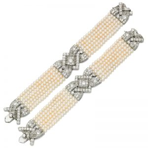 Lot 487 - Pair of Natural Pearl and Diamond Bracelets, 1930s, and six loose natural pearls