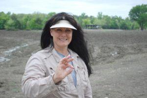 Susie Clark holding the 3.69-carat, Hallelujah Diamond between her fingers