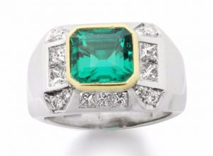 Lot 53 - An Emerald and Diamond Dress Ring. circa 1950