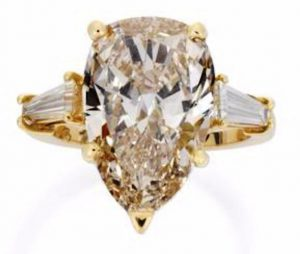 Lot 143 - A Fancy Colored  Diamond Single Stone Ring