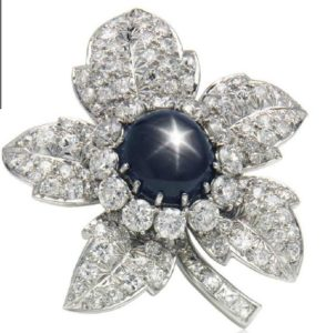 Lot 155 - Black Star Sapphire and Diamond Brooch