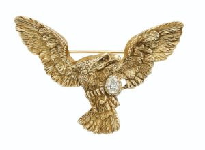 Lot 670 - Gold and Diamond Eagle Brooch