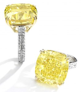 Lot 137 - Platinum, Gold, Fancy Intense Yellow Diamond and Diamond Ring