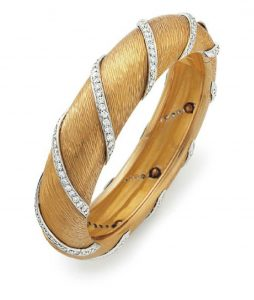 Lot 161 - Gold and Diamond Bangle Bracelet by Bulgari