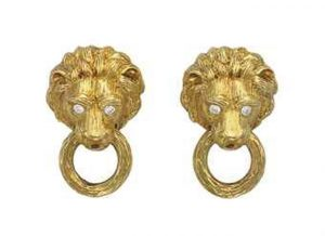 Lot 163 - Pair of Diamond and Gold Ear Clips by Van Cleef & Arpels