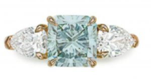 Lot 42 - A Colored Diamond and Diamond Ring