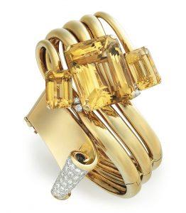 Lot 26 - A Retro Citrine, Diamond and Gold Bangle Bracelet